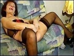 Dirty horny masturbating granny in black thigh highs